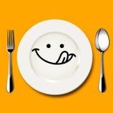 Το διάνυσμα του πεινασμένου προσώπου επισύρει την προσοχή στο άσπρο πιάτο Στοκ Εικόνες