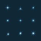 Το διανυσματικό σύνολο σπινθηρίσματος ανάβει τα αστέρια Στοκ Φωτογραφίες