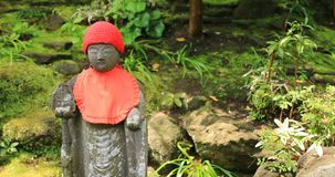 Το ιαπωνικό άγαλμα στον παραδοσιακό σε Hokokuji σε Kamakura φορητό απόθεμα βίντεο