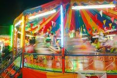 Το ιπποδρόμιο ή εύθυμος πηγαίνει γύρω από στο ταϊλανδικό ύφος Στοκ Φωτογραφίες