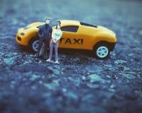 Το κίτρινοι ταξί και οι λαοί είναι παιχνίδι Στοκ Εικόνες