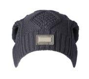 το καπέλο ανασκόπησης απ&omi καπέλο πλεκτό σκούρο μπλε καπέλο Στοκ Εικόνα