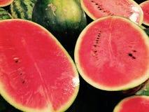 Το καρπούζι παρουσιάζει κόκκινο μέσα στοκ εικόνα