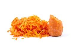 το καρότο έξυσε κατά το ήμισυ μερικοί Στοκ εικόνες με δικαίωμα ελεύθερης χρήσης