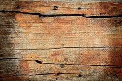 Το κατασκευασμένο πρότυπο του κοκκίνου έσπασε το ξύλινο χαρτόνι Στοκ Φωτογραφία