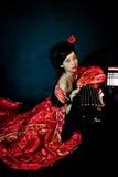 Το κινεζικό κορίτσι έντυσε στο κλασσικό φόρεμα Στοκ φωτογραφίες με δικαίωμα ελεύθερης χρήσης