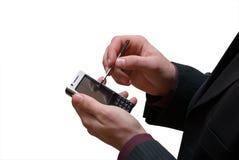 το κινητό τηλέφωνο δίνει την αρσενική οθόνη επαφής Στοκ εικόνες με δικαίωμα ελεύθερης χρήσης