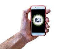 Το κοινωνικό MEDIA που εμπορεύεται το χέρι έννοιας που κρατά κινητό απομονώνει στο λευκό Στοκ εικόνες με δικαίωμα ελεύθερης χρήσης