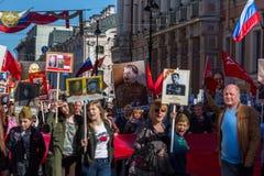 Το κομμουνιστικό κόμμα εμπλέκεται κατά τη διάρκεια του αθάνατου συντάγματος Μάρτιος δράσης Στοκ Εικόνα