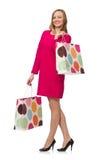 Το κορίτσι αγοραστών πλαστικές τσάντες εκμετάλλευσης φορεμάτων που απομονώνεται στις ρόδινες στο μόριο Στοκ φωτογραφίες με δικαίωμα ελεύθερης χρήσης