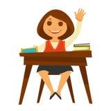 Το κορίτσι κάθεται στο γραφείο με τα εγχειρίδια και αυξάνει το χέρι της Στοκ εικόνες με δικαίωμα ελεύθερης χρήσης