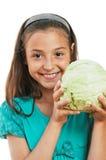 Το κορίτσι κρατά το λάχανο Στοκ Εικόνες