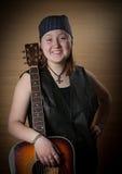 Το κορίτσι με μια κιθάρα Στοκ φωτογραφία με δικαίωμα ελεύθερης χρήσης