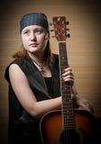 Το κορίτσι με μια κιθάρα Στοκ Εικόνες
