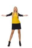 Το κορίτσι ξανθών μαλλιών στον κίτρινο και μαύρο ιματισμό Στοκ Φωτογραφίες
