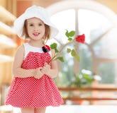 το κορίτσι λουλουδιών αυξήθηκε Στοκ Εικόνες