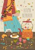 Το κορίτσι πίνει το τσάι στον πίνακα που θερμαίνει στο κρύο καιρό Στοκ Εικόνες
