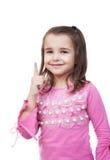 Το κορίτσι παρουσιάζει ένα σημάδι της προσοχής Στοκ Φωτογραφίες