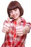 το κορίτσι που δίνει το πουκάμισο γέλιου φυλλομετρεί επάνω στοκ φωτογραφία