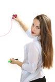 Το κορίτσι σύρει έναν δείκτη γραφικών παραστάσεων Στοκ εικόνες με δικαίωμα ελεύθερης χρήσης