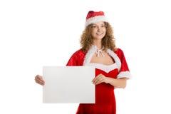 Το κορίτσι Santa κρατά το οριζόντιο κενό έγγραφο Στοκ εικόνα με δικαίωμα ελεύθερης χρήσης