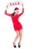 Το κορίτσι Santa στην πλήρη αύξηση παρουσιάζει πώληση εμβλημάτων τρισδιάστατος ετήσιος χειμώνας πώλησης εκπτώσεων Χριστουγέννων Στοκ Φωτογραφία
