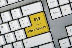 το κουμπί κάνει τα χρήματα Στοκ Εικόνα