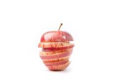 το κόκκινο ανασκόπησης μήλων τεμάχισε το λευκό Στοκ Εικόνες