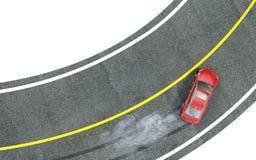 Το κόκκινο αυτοκίνητο εισάγει τη στροφή με την ολίσθηση στοκ εικόνα με δικαίωμα ελεύθερης χρήσης