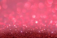 Το κόκκινο και το ροζ ακτινοβολούν αφηρημένο υπόβαθρο με το bokeh το λι στοκ εικόνες