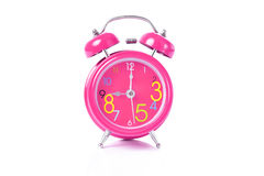 Το κόκκινο ξυπνητήρι παρουσιάζει 11 η ώρα Στοκ Εικόνα