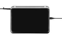 Το κλειστό μαύρο lap-top με συνδέει τις συζεύξεις που συνδέονται Στοκ Εικόνες