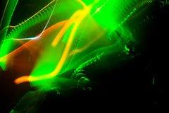 Το λέιζερ παρουσιάζει, πράσινος και πορτοκαλής σε μια λέσχη Στοκ εικόνες με δικαίωμα ελεύθερης χρήσης