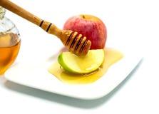 Το μέλι και το μήλο είναι παραδοσιακά εβραϊκά τρόφιμα για το hashana Rosh Στοκ Φωτογραφία
