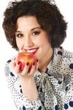 το μήλο τρώει τη γυναίκα Στοκ φωτογραφία με δικαίωμα ελεύθερης χρήσης