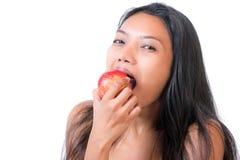 το μήλο τρώει την κόκκινη γυναίκα Στοκ εικόνα με δικαίωμα ελεύθερης χρήσης