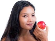το μήλο τρώει την κόκκινη γυναίκα Στοκ φωτογραφία με δικαίωμα ελεύθερης χρήσης