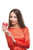 το μήλο τρώει την κόκκινη γυναίκα Στοκ Εικόνα