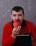 το μήλο τρώει το άτομο Στοκ φωτογραφίες με δικαίωμα ελεύθερης χρήσης