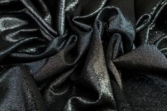 Το μαύρο ύφασμα με τα τσέκια είναι πτυχές στοκ εικόνες με δικαίωμα ελεύθερης χρήσης