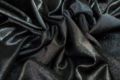 Το μαύρο ύφασμα με τα τσέκια είναι πτυχές στοκ εικόνα