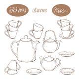 Το μεγάλο καθορισμένο εργαλείο περιλαμβάνει τα φλυτζάνια, teapots και πιάτα, στο άσπρο υπόβαθρο Απεικόνιση αποθεμάτων