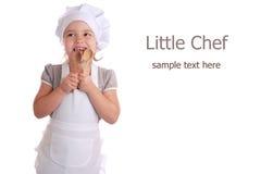 Το μικρό κορίτσι έντυσε ως μάγειρας Στοκ Εικόνες