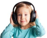 Το μικρό κορίτσι ακούει μουσική Στοκ Εικόνες