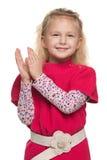 Το μικρό κορίτσι επιδοκιμάζει στοκ εικόνες