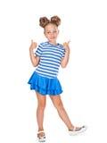 Το μικρό κορίτσι παρουσιάζει χειρονομία ΕΝΤΆΞΕΙ Στοκ Εικόνες
