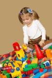 Το μικρό κορίτσι που παίζει το σχεδιαστή Στοκ Εικόνες