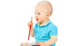 Το μικρό παιδί κρατά ένα μολύβι Στοκ φωτογραφία με δικαίωμα ελεύθερης χρήσης