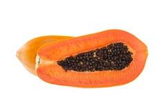 Το μισό από κίτρινο papaya στο άσπρο υπόβαθρο Στοκ εικόνα με δικαίωμα ελεύθερης χρήσης