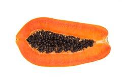 Το μισό από κίτρινο papaya στο άσπρο υπόβαθρο Στοκ Εικόνες